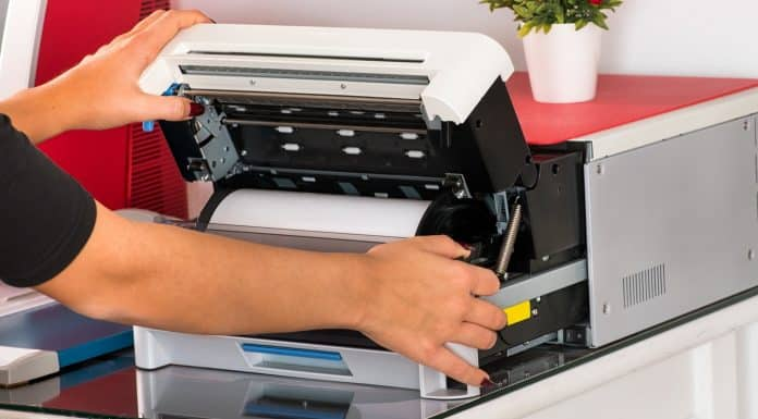 Woman open a sublimation printer in a print shop