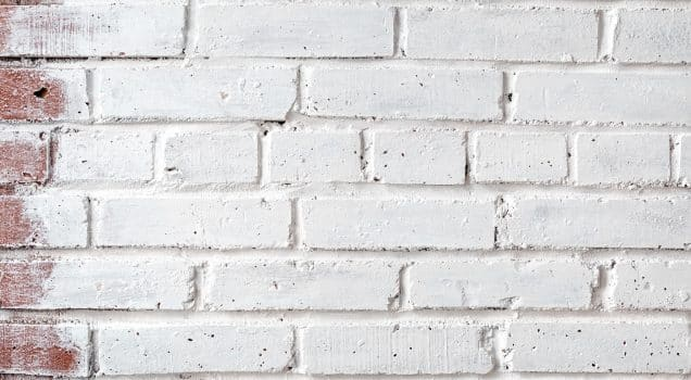 Brick wall painted with white paint