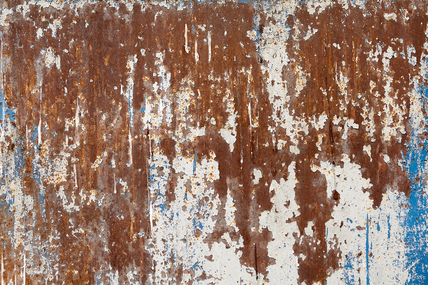 Surface of steel wall with peeling paint and corrosion, texture backdrop.