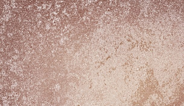 Roughly pink gold painted concrete wall surface background