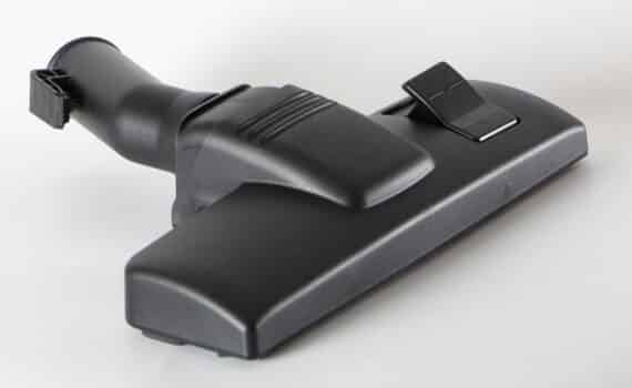 Black nozzle for vacuum cleaner on a white background close up