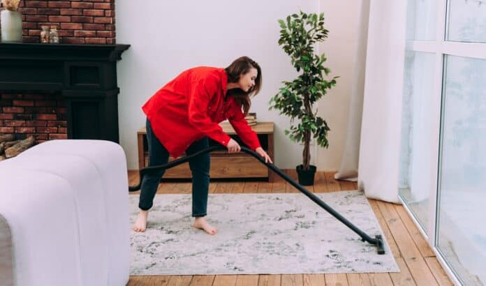 lifestyle moments of a young woman at home. Woman cleaning the apartment up