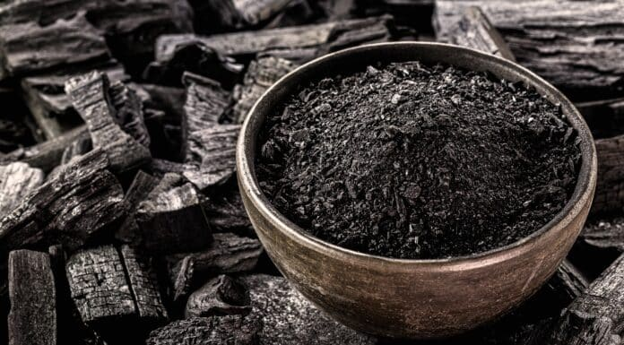 powdered charcoal, ground in a handmade clay bowl. With coal bottom to bottom, used in the beauty industry