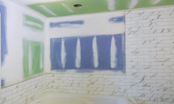 New under construction bathroom interior with drywall and patching drywall tape bathroom