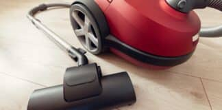 vacuum cleaner of red color with turbo-brush on a gray laminate