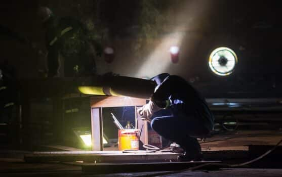 Man work weld at the industry tank oil and gas